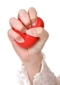 Woman's hand squeezing a stress ball