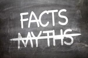 Chalkboard with myths crossed out and facts written above it
