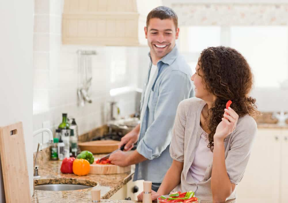 Happy couple cutting vegetables in the kitchen