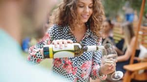 Girl pouring wine into glass