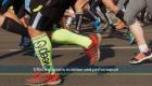 many legs of people in sports gear in a marathon