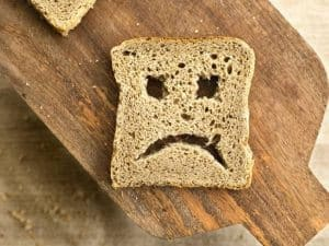 Bread with sad face cut out